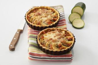 Tartelettes aux quenelles brochet, courgettes grillées, tomates et mozzarella