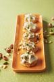Recette : Rondelles de quenelles lyonnaises volaille morilles, chantilly à la fourme d'Ambert au siphon et éclats de fruits secs