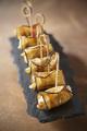 Recette : Roulés d'aubergine aux mini quenelles à poêler, noix, coriandre et fromage frais